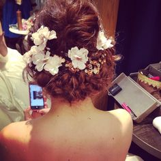 Messy braid with flowers and jewels