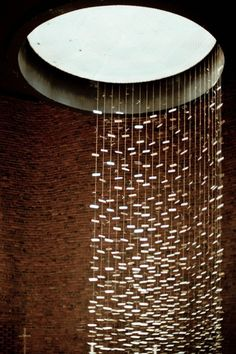 MIT Chapel by Eero Saarinen (with a waterfall metal sculpture by Harry Bertoia that shimmers in the sunlight reflecting and distributing light into the interior of the chapel)