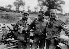 Warcorrespondentsand close friends   Robert Capa andErnest Hemingwaywith their driver, Olin L. Tompkins, photographed on the eve of the D-Day landings June 5, 1944.