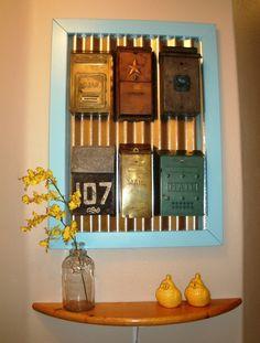 Vintage mailboxes framed over corrugated metal