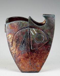 Ceramics by Shaun Hall at Studiopottery.co.uk - Neptune - Scarva earthstone handbuilding clay, (small-medium size) Earthstone Raku glaze, (reduced), dimensions h approx 20cm x 17 cm w price including postage