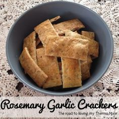 Earlier today I posted my Olive Oil Crackers. These are a variation on them - Rosemary Garlic Crackers!  I