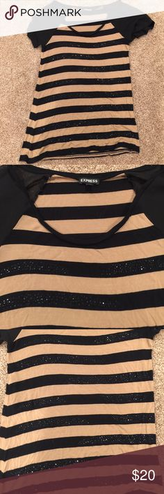 Express black and gold blouse. Black and gold express blouse. This shirt has black sparkles on it. Express Tops Blouses