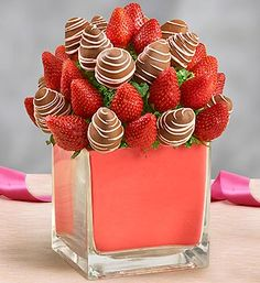The classic romantic gesture gets updated just in time for the one you love. Juicy strawberries and beautifully decorated and dipped strawberries arrive in a thoroughly modern vase.