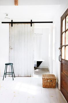 white washed sliding barn door for the bathroom