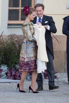 Princess Madeleine of Sweden carries son Prince Nicolas on the day of his christening in Stockholm.   - TownandCountryMag.com
