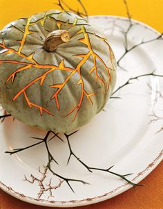 "Carve pumpkin to match your china! Draw and cut a pattern based on your plate design. ""Thorny vines"" pumpkin reflects pattern of this antique transfer ware."