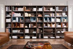 A home library is the perfect way to turn a spare room into a relaxing environment. This article gives ideas on how to design and style your home library. Dresser Bar, Home Catalogue, Apartment Entryway, Built In Bookcase, Living Room Bedroom, Living Rooms, Living Spaces, Made In France, Spare Room