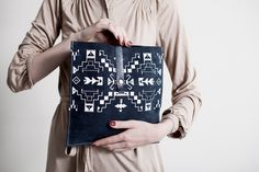 this store has too many amazing patterned clutches! Tribal Pattern Leather Suede Navy Blue with White No. LP-101. $52.00, via Etsy.
