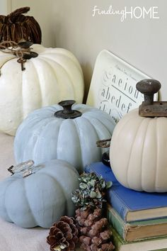 To change stems, you may need to use an exacto knife to cut the stem off. Some of cheaper pumpkin's stem will just pop off. You may want to paint pumpkins your color choices. (some white ones look great without paint) Here, she used a beige craft paint on one, a blue chalk paint on one and the third one I layered two colors of blue chalk paint.  It is all about using what you have - add some twine with some vintage rusty keys tied to a pumpkin.