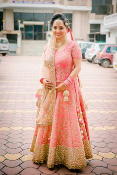 Real Indian Weddings - Simran and Bipin | WedMeGood | Beautiful Bride Simran in a Pink Bridal Lehenga with Gold Sequence and Thread Work with Cream and Pink Latkans  Picture Courtesy: Phototantra #wedmegood #bridal #pink #gold #realwedding