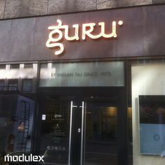 Looking at some of our lovely facade signage. Guru is an indian restaurant in the centre of Copenhagen. The facade logo is made of copper, lacquered to avoid maintenance. Led light is built in to each individual letter. Restaurant Facade, Restaurant Logo Design, Restaurant Names, Burger Restaurant, Shop Signage, Signage Design, Cafe Design, Indian Cafe, Restaurant Indien