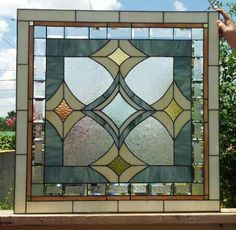 This piece was designed to add privacy and elegance to a bathroom window. I love the color combination.