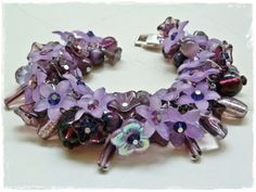 The multiple shades of purple chunky style charm bracelet.