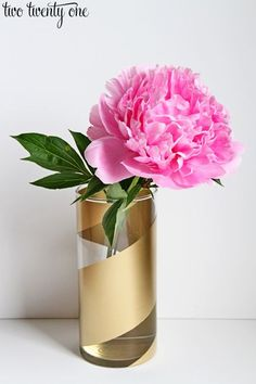 10 Projects with Spray Paint • Tutorials, including this DIY gold striped vase by 'Two Twenty One'!