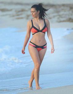 Kim Kardashian shows off curves in an orange and black bikini