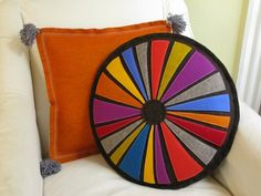 Color Wheel Pillow by Cheeky Monkey Home, available on Etsy!  I just want to look at this all day.