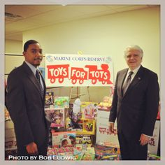 We're off to make our donation to Toys For Tots! Here is Dr. Hayes with President Miyares getting the toys ready to go! #UMUCPhotoOfTheDay