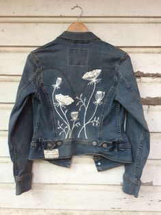 ft lonesome flowers embroidered onto a denim jacket