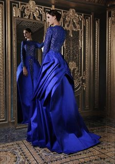 Its nice to see a long-sleeved evening gown for a change.