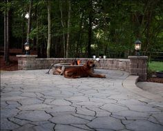 What do you get when you put a dog near a fire pit?  A hot dog!  And a nice, cozy outdoor living area…for humans, too.