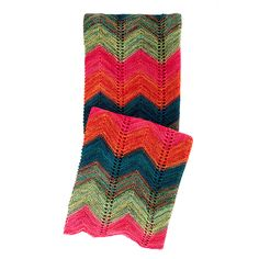 Our crafty throw was hand knit with neon colored acrylic yarns in a zig zag pattern in colors of the desert landscape at sunset. Clean finished edges on top and bottom only add to its funky appeal.