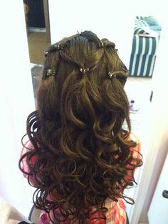 Flower girl hairstyle. I jut did my niece Mia's hair for a wedding. She's such a trooper!