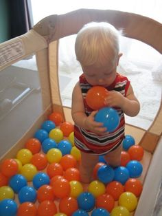LOVE this! The ball will stay put and so will the child! > brilliant! Turn the pack and play into a ball pit- just buy balls! Why didn't I think of this before?!