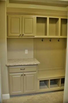 I like the idea of putting a small cabinet with a countertop in the mud room. Maybe with a basket for keys, phones, etc.: