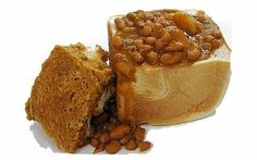 The bunny chow, a hollowed out half loaf of bread filled with curry, a typical Indian-South African dish - Delicious food in South Africa, South African food guide South African Dishes, South African Recipes, Indian Dishes, Indian Food Recipes, Bean Bunny, Beef Steak Recipes, Beans Curry, Good Food, Yummy Food