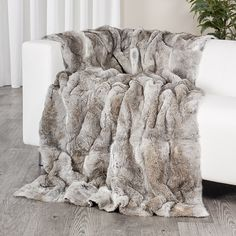 4c20f3330a This rabbit fur chinchilla grey blanket is made with all real rabbit fur  pelts. It s