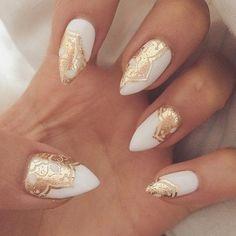 White and Gold Stiletto Nails.