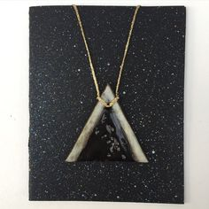 Handmade ceramic necklace by Christy Nyboer  item No.04 - triangle shape with triangular lines illustration in gold paint - chocolate brown clay