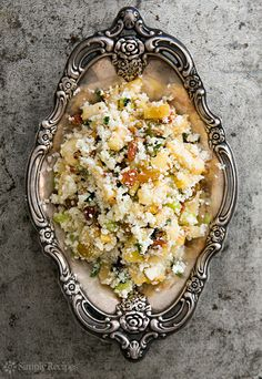 "Cauliflower ""Couscous"" Recipe - Cauliflower couscous? Why not? Of course nothing beats true, steamed to perfection, durum wheat couscous. But for those of us avoiding wheat, cauliflower couscous is a tasty and practical solution. #food #paleo #grainfree #glutenfree #dairyfree #sidedish #couscous #cauliflower"