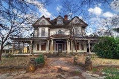 Abandoned, old house in downtown Dawson, Georgia. I bet it was magnificent back in the day, such a waste of good bones...