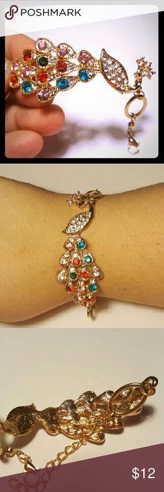 Beautiful Peacock Bracelet Gold tone peacock bracelet with differwnt color rhinestones. Brand New, never worn. Jewelry Bracelets