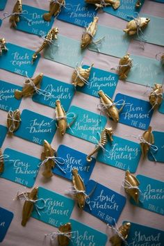 Ombre blue escort cards and sea creature figurines for a beach wedding theme