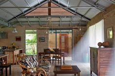 The key to comfort in the tropics is ventilation - lots of it. We used supporting earth walls as sparingly as possible. Big panels of sliding glass open to mimic the original concept of a Hawaiian hale. Open gable ends and cupolas keep the air flowing through the pavilions. Breezeways accelerate air movement.   Image © Art Gray
