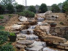 Garden Ideas Sloped Backyards fire pit water feature ideas    fire pits retaining walls