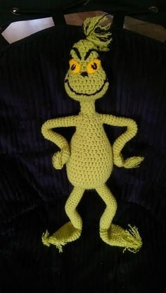 This FREE Mr. Grinch inspired crochet pattern is available exclusive to YarnWars friends! Now you can make your own adorable Mr. Grinch doll with neckpiece