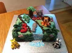 Jungle cake for a boy's 3rd birthday. Fondant lion, zebra, elephant, hippo, crocodile and giraffe.