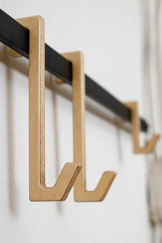 Ob.Mod.Han.G is wall hanger. The minimalist appearance easily suits any hallway or bedroom. The design of Ob.Mod.Han.G is a combination of a metal profile and playful wooden hooks. Ob.Mod.Han.G is made in two sizes. Small with 4 hooks and large with 6 hooks. Profile Design, Wall Hanger, Hooks, Strawberry, Objects, Minimalist, House Design, Suits, Bedroom