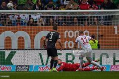 Jonathan Schmid of Augsburg, Goalkeeper Timo Horn of Colonge and Dominique Heintz of Colonge battle for the ball during the Bundesliga match between FC Augsburg and 1. FC Koeln at WWK Arena on April 15, 2017 in Augsburg, Germany.