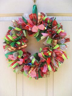 Easy make wreath. Use 1 yd of various-colored fabrics (depending on holiday or your decor), cut or torn into 1x6 in strips.  Bend hanger into circle, use longer fabric strip to cover hook at top.  Tie strips on, alternating colors/prints until wreath is full.  Fluff & hang.