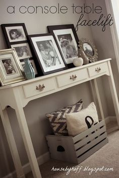 Console table decorated with frames on top