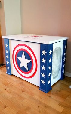 This toy box was made for a young boy whose name is inscribed inside the soft close lid. He has lots of toys and loves Captain America and other Marvel characters. Toy box, Captain America, Spiderman, Ironman, Marvel, bespoke toy box, personalised toy box, www.pqpod.co.uk, red white and blue, Boxes for Living, Carved toy box, carved storage box, home storage