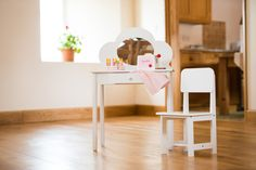 White wooden dressing table for children with a round plexiglass safety mirror. £49.99 from Sue Ryder Online Shop.