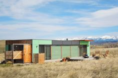 "Shipping Container Home Livingston, MT, United States  Welcome to the ""Little Box on the Prairie"". This unique, modern house is made from two recycled shipping containers, situated on 10-acres of rolling prairie, just North of Livingston Montana. It's a 700 square-foot mix of rustic coziness and clean, modern design. Many of the finishes such as the redwood flooring and plywood wall panels were salvaged off site, recycled and reused. The outside deck is perfect for chatting over morning…"