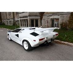 """COUNTACH - After christening the Urraco after a bull breed, in 1974, Lamborghini broke from tradition, naming the Countach not for a bull, but for """"contacc"""" a Piedmontese expletive.  Legend has it that stylist Nuccio Bertone uttered the word in surprise when he first laid eyes on the Countach prototype, """"Project 112"""". Maserati, Bugatti, Lamborghini, Ferrari, Mclaren Mercedes, Mercedes Benz, Porsche, Exotic Sports Cars, Koenigsegg"""