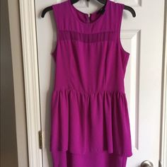 H&M dress Fuchsia sleeveless H&M dress. Double layer skirt makes it even more striking. Seem slightly coming apart in the small split (see pic). Not  noticeable. Size 8 but seems to run small. Fits like a 4. H&M Dresses